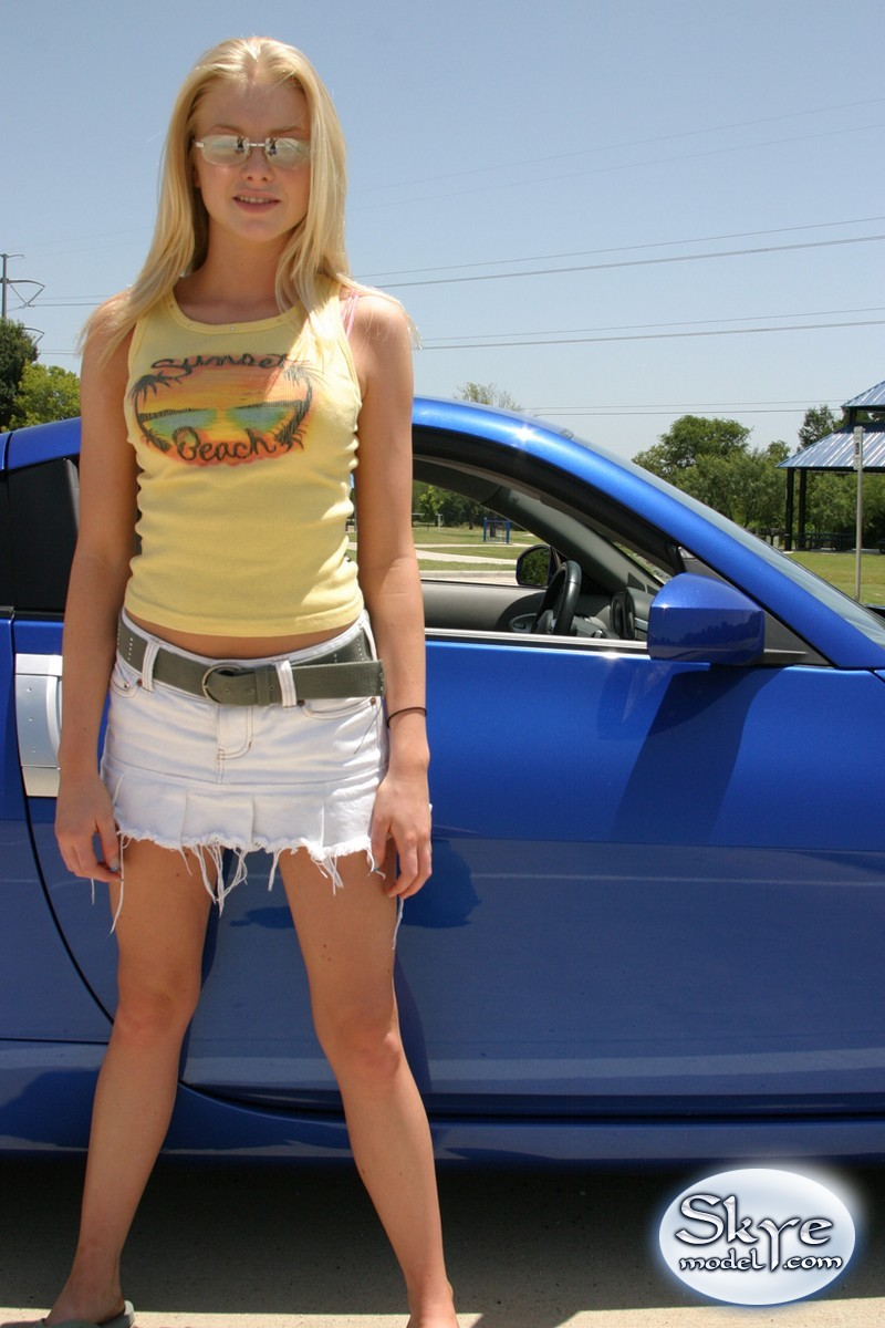 Blonde teen Skye Model shows off her tight teen body by