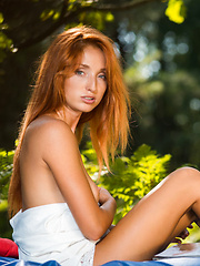 Erotic picture of Alluring Michelle H shows off her lusty body in the woods.