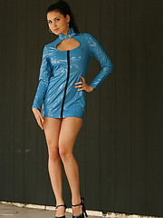 Erotic picture of Bailey wants to be a a Bond girl in her shiny blue vinyl dress