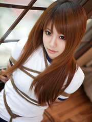 Erotic picture of Dimdim Asian in long socks and sports outfit has hands tied