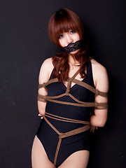 Erotic picture of Lala Asian babe in bath suit has hands tied of her boobs in ropes