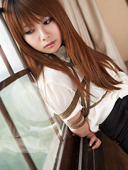 Erotic picture of Dimdim Asian in tight office skirt and blouse is tied in ropes