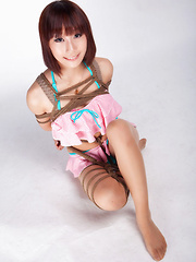 Erotic picture of Ayako Asian leering babe has big smile on face as is tied in rope