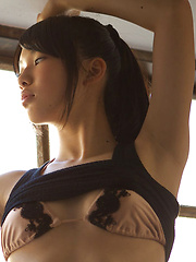 Erotic picture of Tomoe Yamanaka Asian in stockings shows nasty behind at window