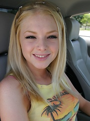 Erotic picture of Blonde teen Skye Model shows off her tight teen body by her friends car