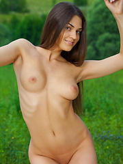 Erotic picture of Vanda B swings naked showing off her tight body