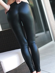 Erotic picture of Teen vixen Catie Minx strips off her black latex leggins