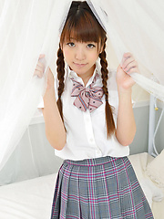 Erotic picture of Mizuho Shiraishi Asian with pigtails and uniform sits with ass up